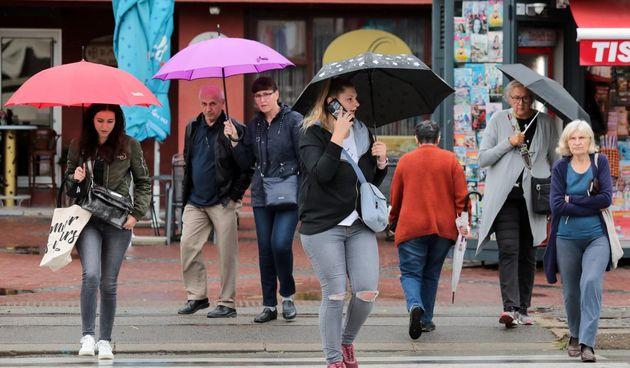 kiša kišni dan prognoza ljudi