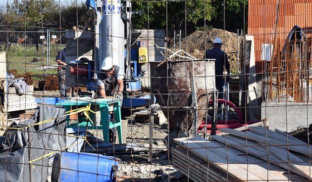 bauštela građevinski radnici zidanje