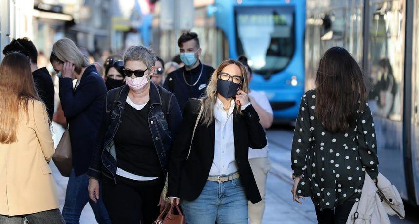 Jesu li maske na otvorenom beskorisne? Mogućnost da se zarazite je manja od jedan posto